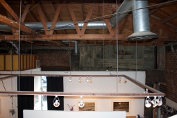 Arial view of the professional track lighting that highlights the art in the gallery.