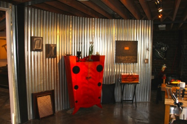 A funky orange cabinet adds tons of personality along the curved wall, part of the indigenous architecture.