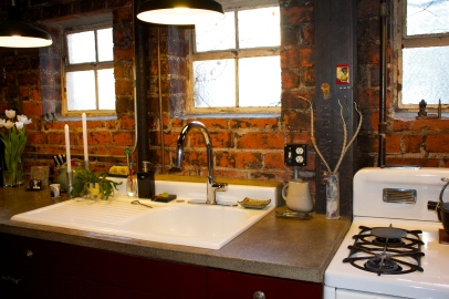 The salvaged sink is metal covered with porcelain and dates back to the 50's.