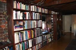 Custom bookcase brilliantly built around the windows.