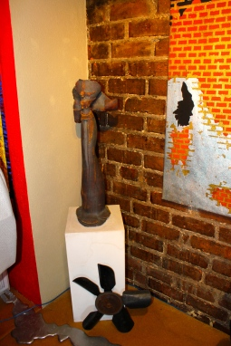 The painting of the brick being exposed mirrors what Ray and Arnée experienced during the renovation.